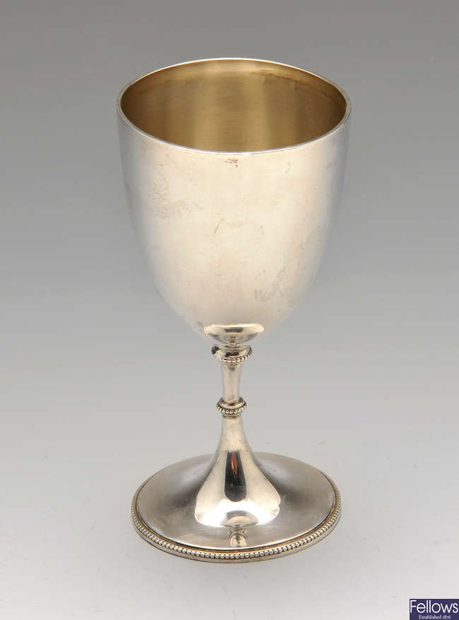 A small Edwardian silver goblet, plus a pair of silver bud vases and two single examples.
