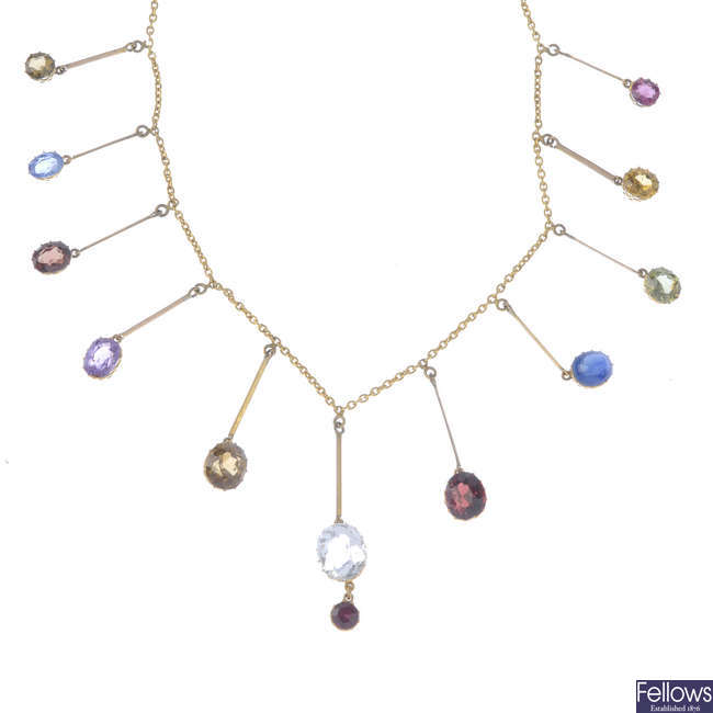 A late Victorian gold multi-gem necklace.