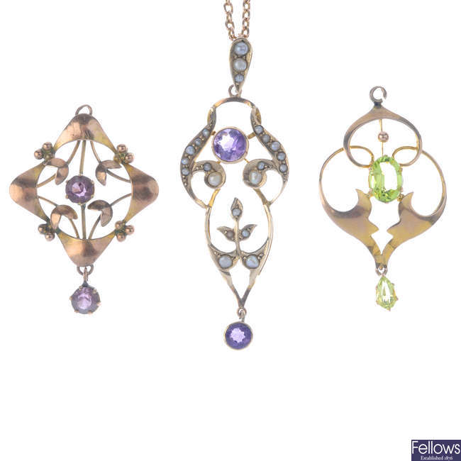 Three early 20th century 9ct gold gem-set pendants and a chain.