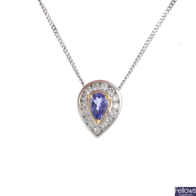 A tanzanite and diamond cluster pendant, with chain.