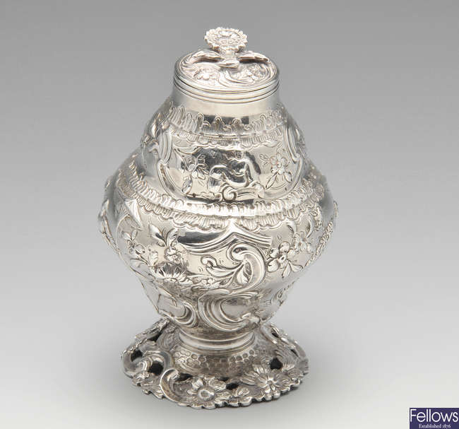 An early George III silver tea caddy with chinoiseire decoration.