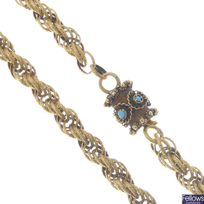 A fancy-link chain with turquoise clasp.