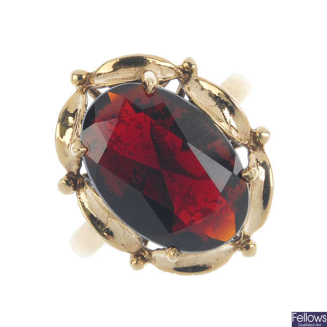 A pair of garnet and diamond earrings and a 9ct gold garnet ring.