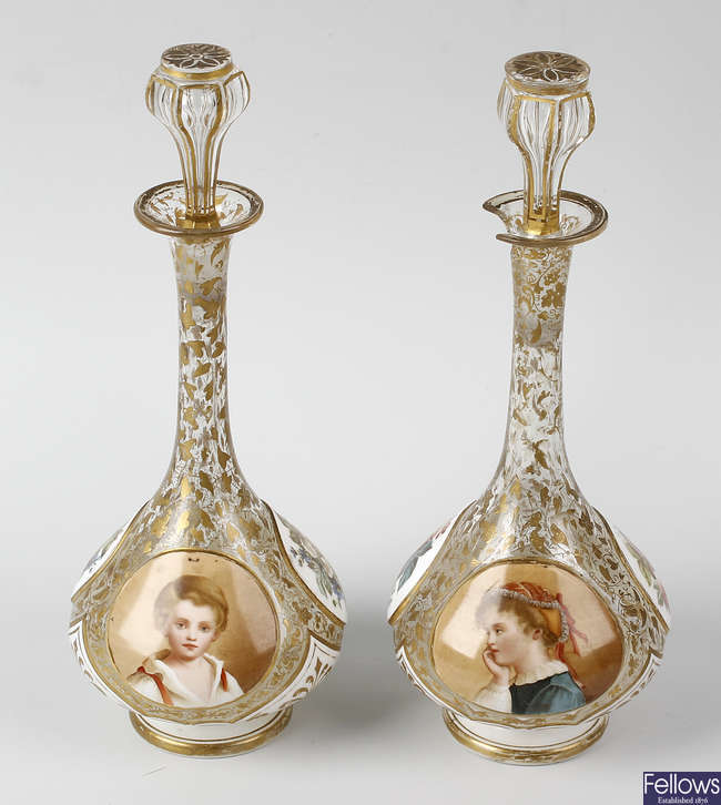 A pair of Bohemian overlay clear glass vases.