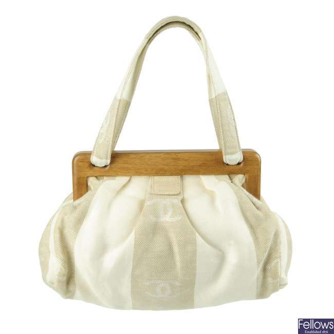CHANEL - a white and beige canvas handbag.