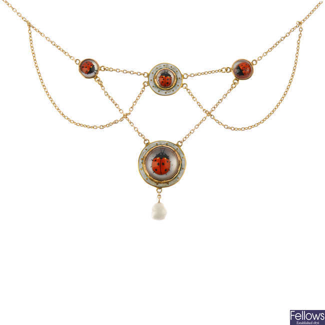 An early 20th century 9ct gold reverse carved intaglio ladybird necklace.