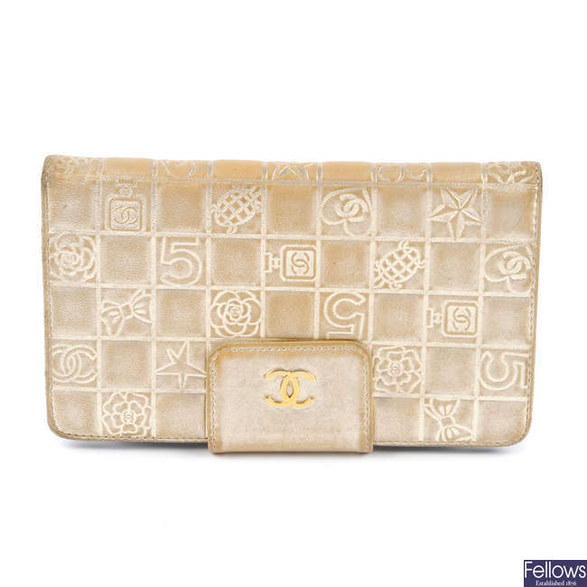 CHANEL - a gold embossed wallet.
