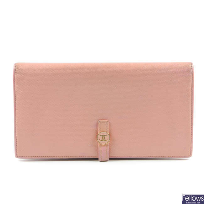 CHANEL - a pink leather wallet.