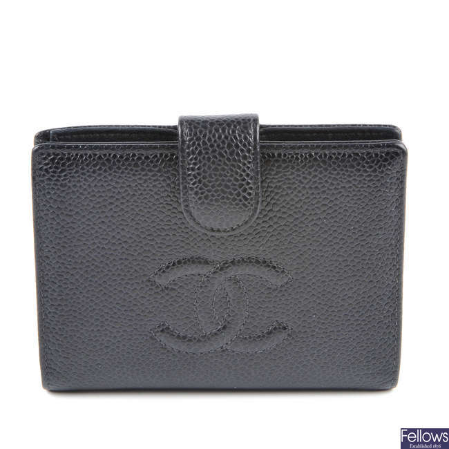 CHANEL - a caviar leather wallet.