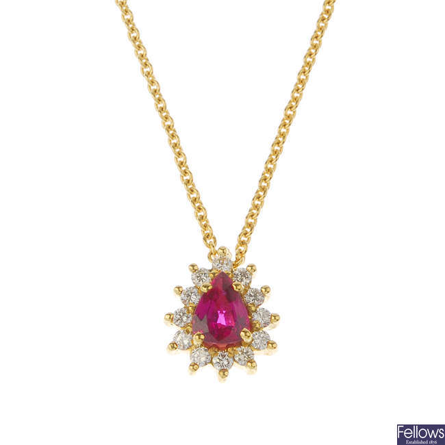 An 18ct gold ruby and diamond cluster pendant.