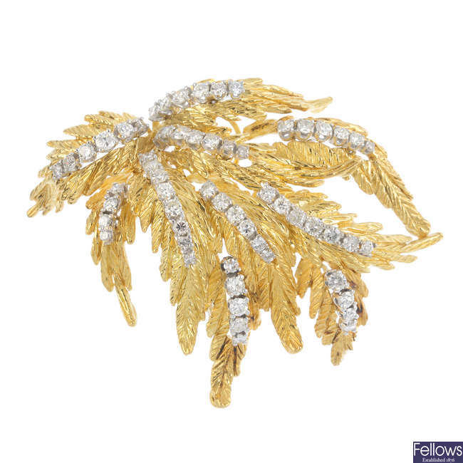 A 1960s 18ct gold diamond brooch.