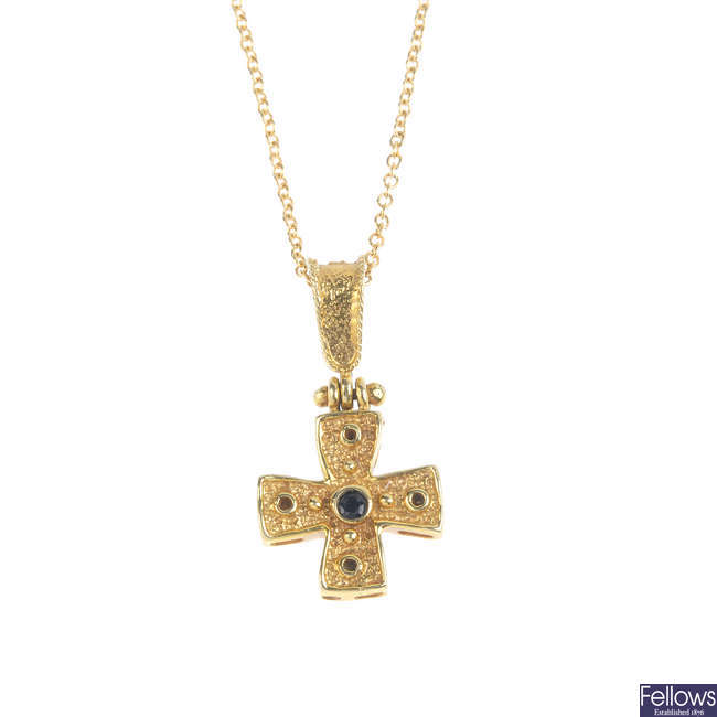 A sapphire cross pendant, with 18ct gold chain.