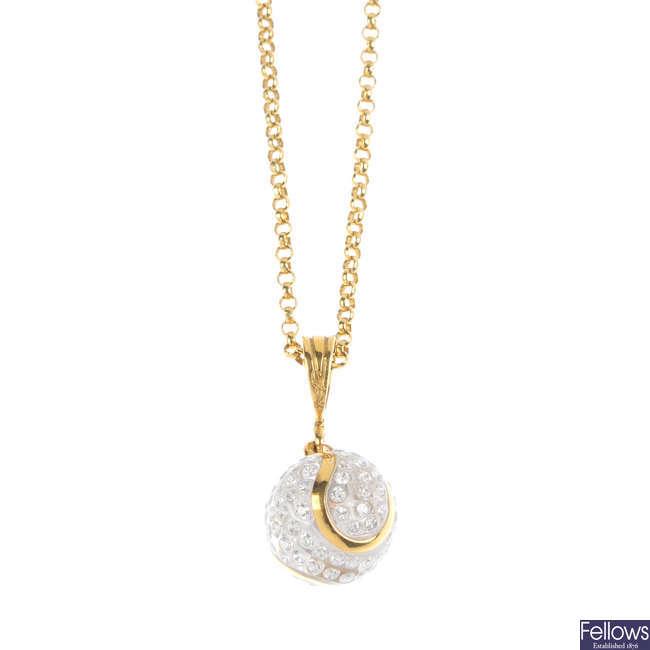 A diamond tennis ball pendant, with chain.