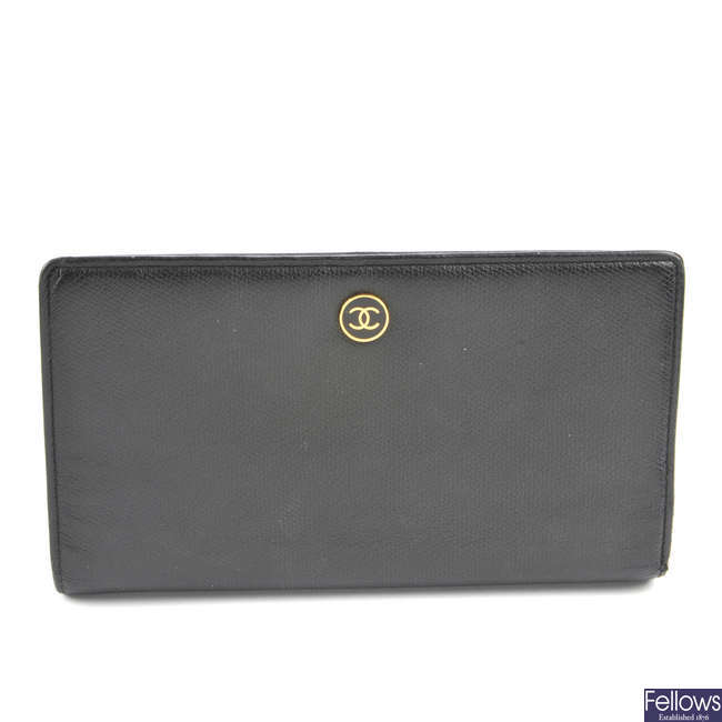 CHANEL - a black wallet.