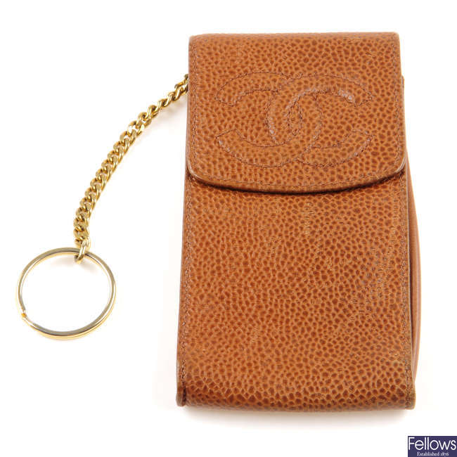 CHANEL - a caviar leather phone case.