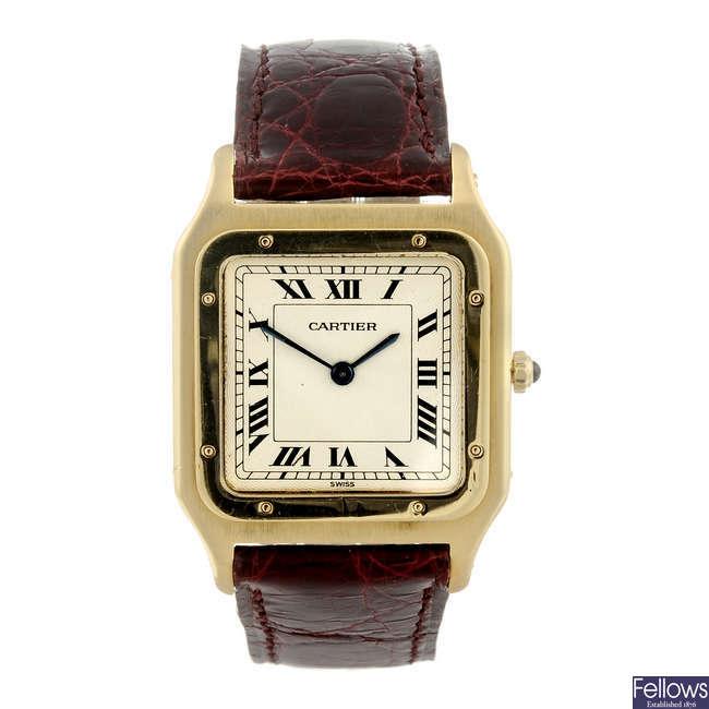 CARTIER - an 18ct yellow gold Santos Dumont wrist watch.