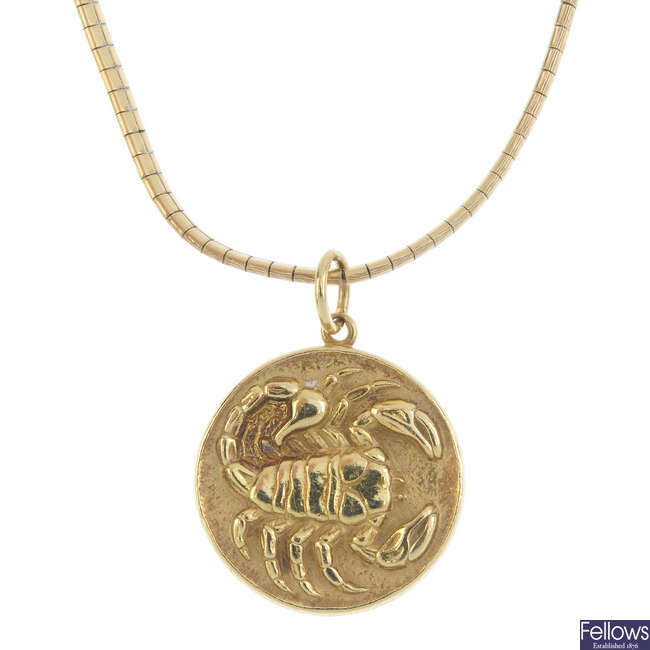 A 1970s 18ct gold zodiac pendant, with chain.
