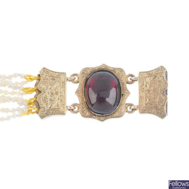 A late Victorian seed pearl eight-row bracelet, with gold garnet cabochon clasp.