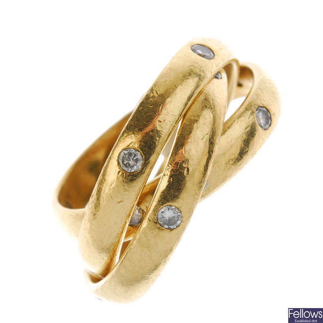 An 18ct gold diamond triple band ring.