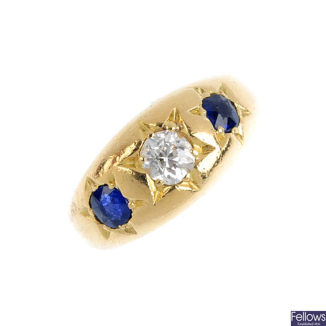 A late Victorian 18ct gold sapphire and diamond three-stone ring.