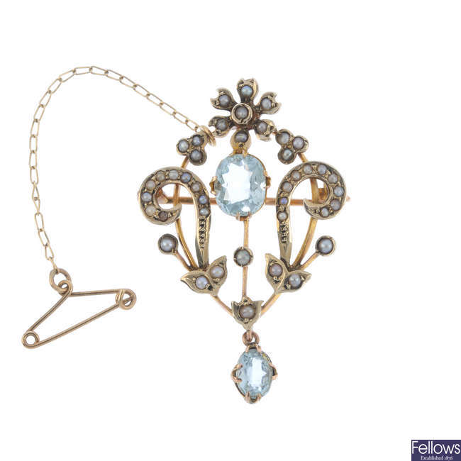 An early 20th century 9ct gold aquamarine and split pearl brooch and 15ct gold chain.