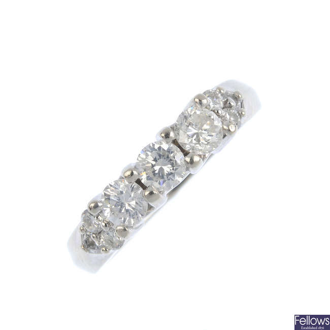 A diamond three-stone ring.