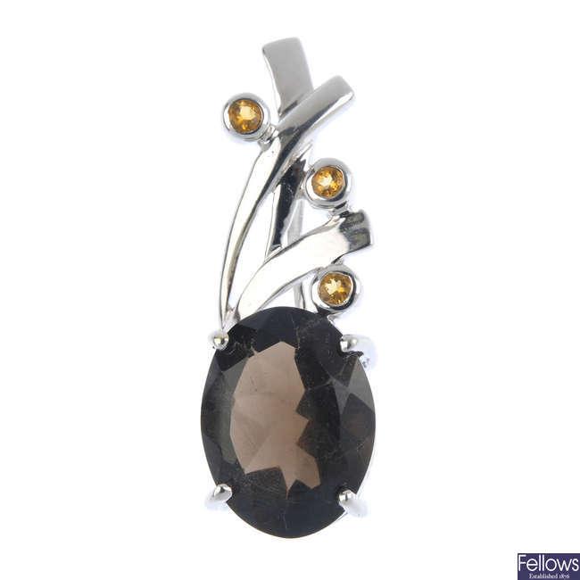 A 9ct gold smoky quartz and citrine pendant.