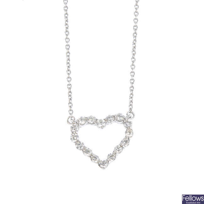 A diamond heart pendant, on a chain.