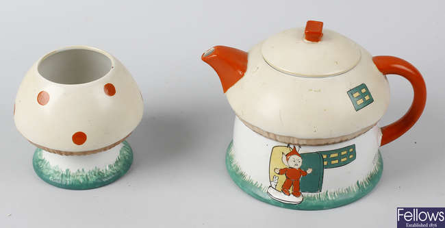 A Shelley Mabel Lucie Attwell 'Boo Boo' novelty teapot, together with a matching sugar basin, and a Pixie 'Boo Boo' character milk jug.