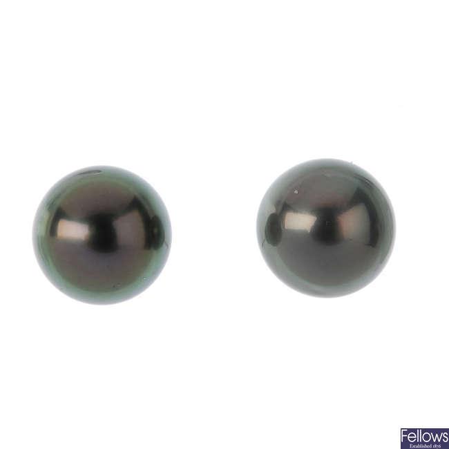 A pair of cultured pearl stud earrings.