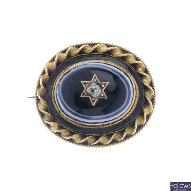 A late Victorian banded agate and diamond memorial brooch.