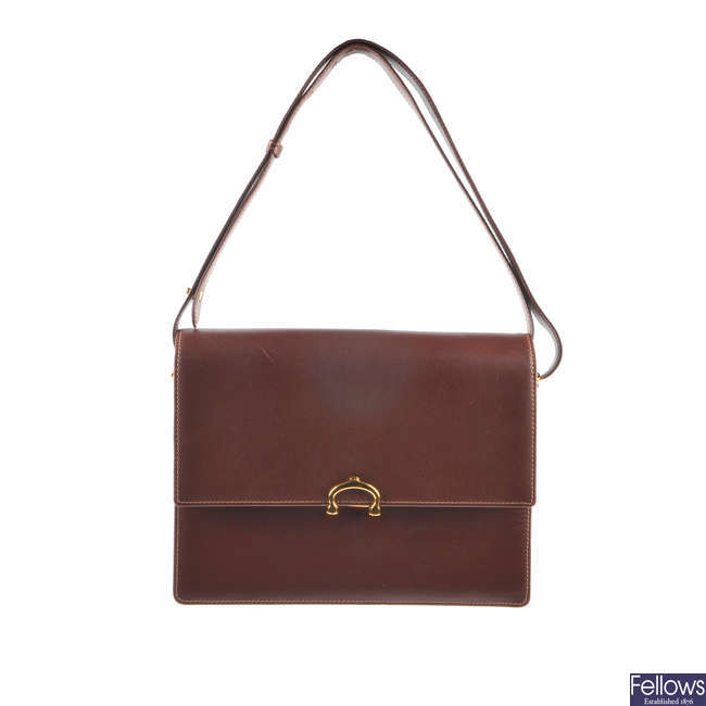 CARTIER - a Bordeaux leather handbag.