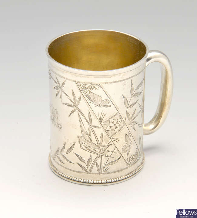 A Victorian silver christening mug decorated in Aesthetic style.