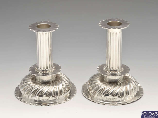 A pair of Victorian silver candlesticks.
