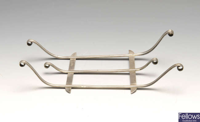 A nineteenth century silver stand, in the form of a sleigh or sledge.