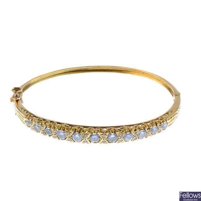 An 18ct gold diamond hinged bangle.