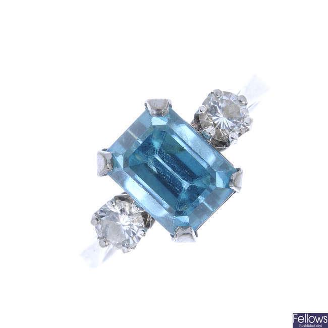 A zircon and diamond three-stone ring.
