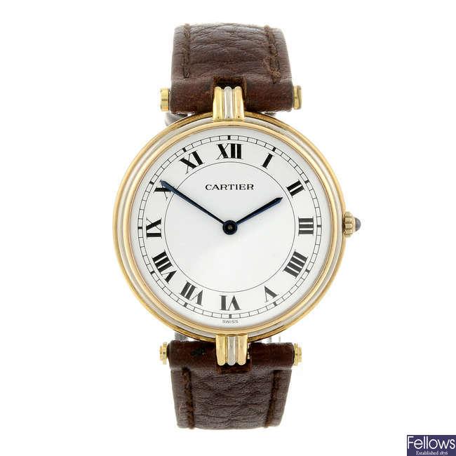 CARTIER - a yellow metal Vendome Trinity wrist watch.