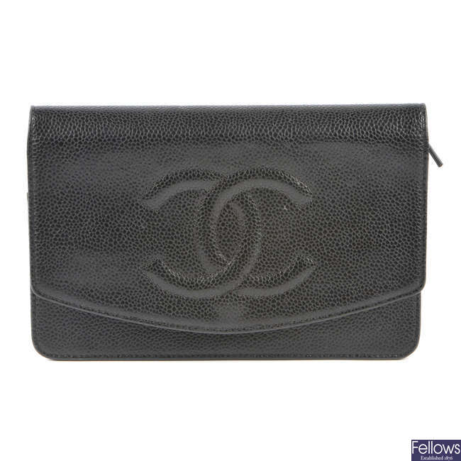 CHANEL - a caviar leather purse with chain