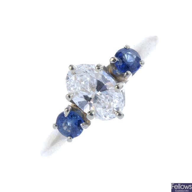 A diamond and sapphire three-stone ring.