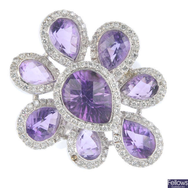 An amethyst and diamond cluster floral dress ring.