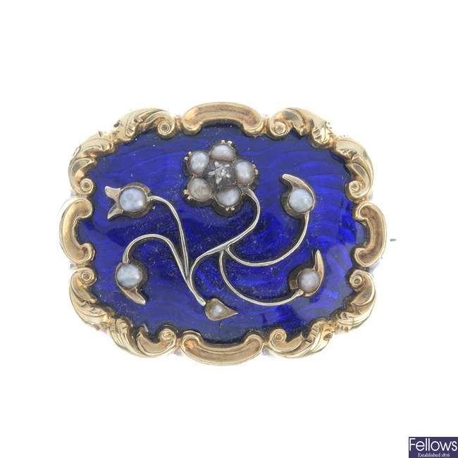 A late Victorian split pearl and enamel memorial brooch.