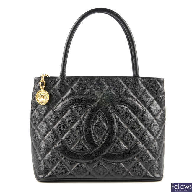 CHANEL - a black quilted caviar leather tote handbag.