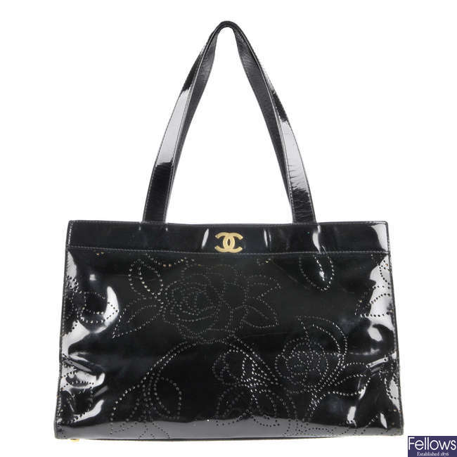 CHANEL - a patent leather camellia tote.