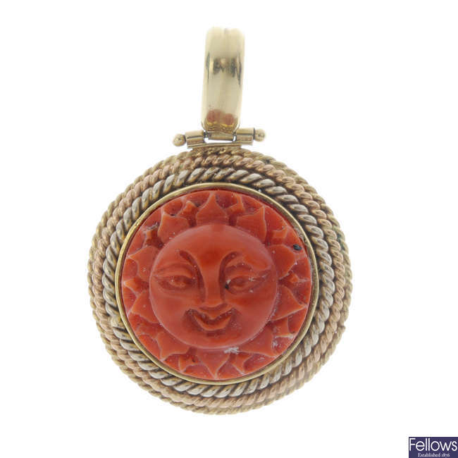 A carved coral pendant.