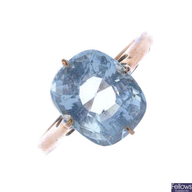 A mid 20th century gold aquamarine single-stone ring.
