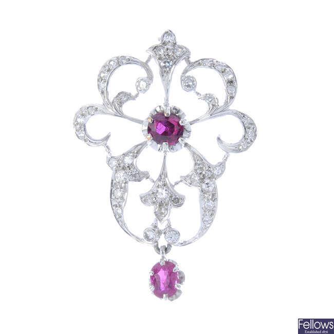 A diamond and ruby pendant.