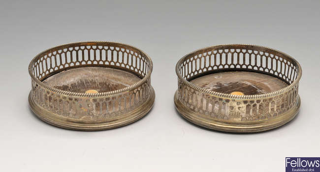 A pair of George III silver mounted wine coasters, plus two silver plated examples.