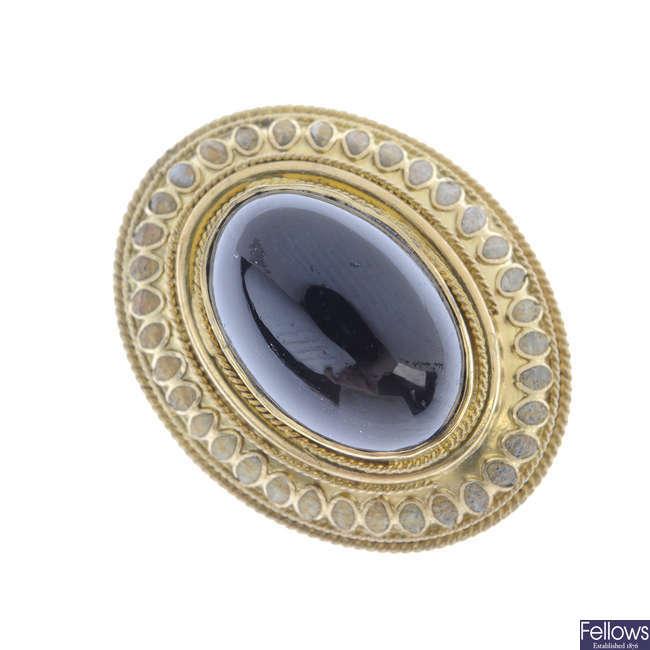 A garnet and enamel ring.