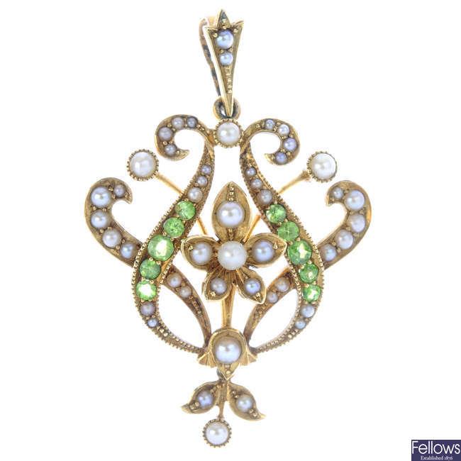 An Edwardian 15ct gold demantoid garnet, seed and split pearl pendant.